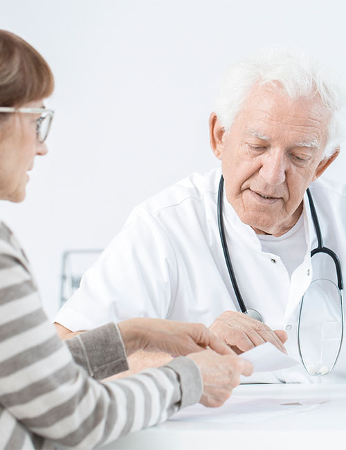Doctor with stethoscope explaining the dosage of medicines to his patient